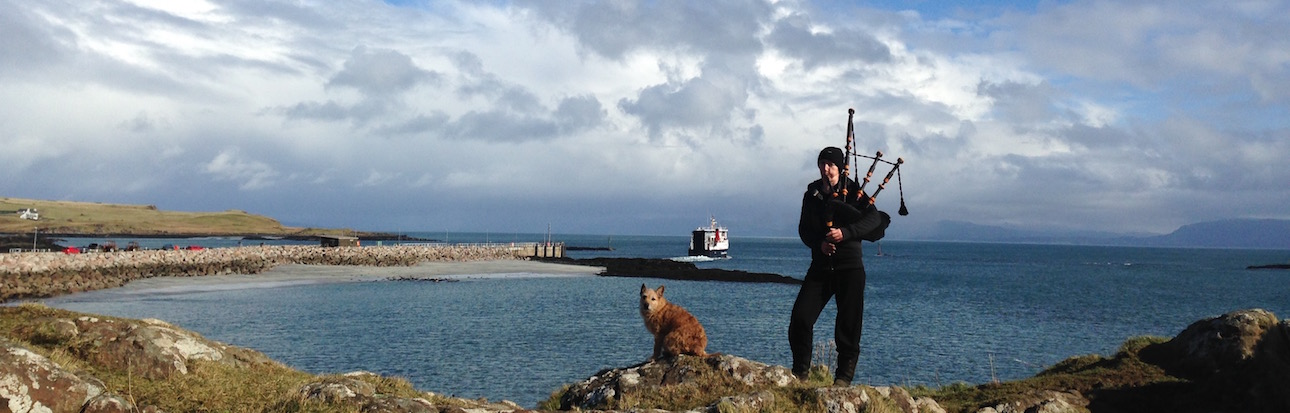 Donna the piper pipes away the Loch Nevis